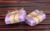 Hand-made lavender soaps on bamboo mat — Stock Photo