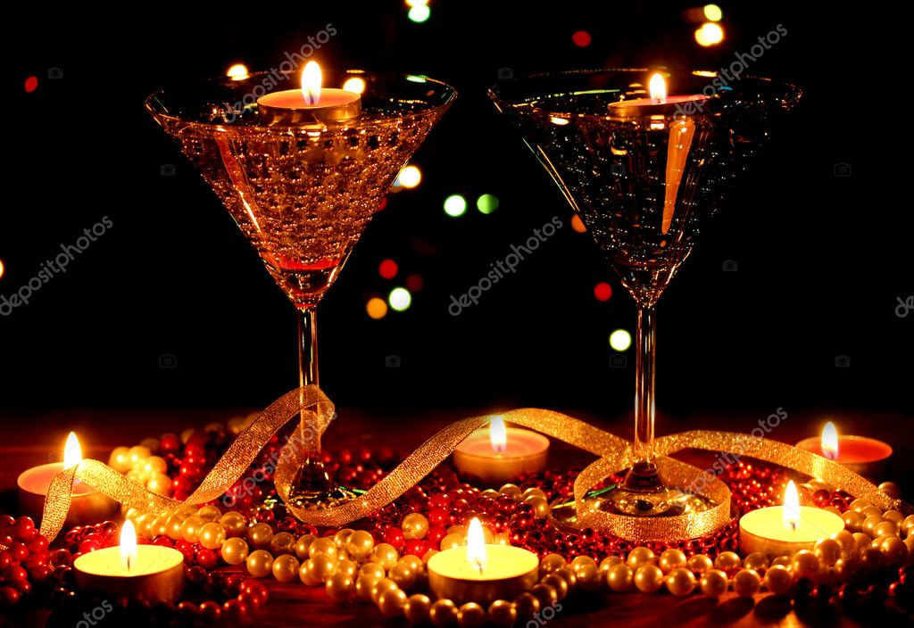 Amazing composition of candles and glasses on wooden table on bright background — Stock Photo #9798777