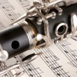 Close up detail of clarinet and notebook with notes — Stock Photo #9805563