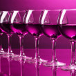 Stock Photo: Wineglasses on pink background