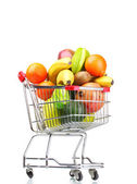 Assortment of exotic fruits in shopping cart isolated on white — ストック写真