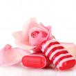 Two soap and pink rose isolated on white - Stock Photo