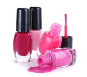 Open bottles with bright nail polish isolated on white — Stok fotoğraf
