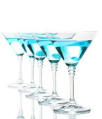 Blue cocktail in martini glasses isolated on white — Stock Photo