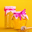 Jars of honey and wooden drizzler on yellow honeycomb background — Stock Photo #9875202