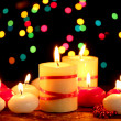 Beautiful candles on wooden table on bright background - Stok fotoğraf