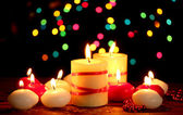 Beautiful candles on wooden table on bright background — Fotografia Stock
