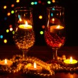 Amazing composition of candles and glasses on wooden table on bright background — Stock Photo #9887891