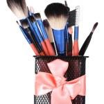 Make-up brushes in holder isolated on white — Stock Photo