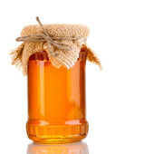 Sweet honey in jar isolated on white — Stock Photo