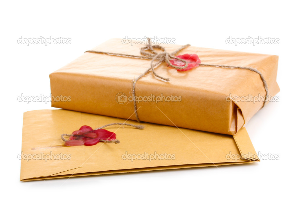 Parcel and envelope with sealing wax isolated on white — Stock Photo #9887840