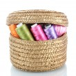 Bright bobbin thread in basket isolated on white - Stok fotoraf