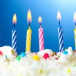 Beautiful birthday candles on blue background — Stock Photo #9894870