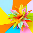 Colorfull origami kusudama on bright paper background — Stockfoto