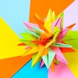Colorfull origami kusudama on bright paper background — ストック写真