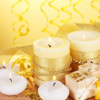 Beautiful candles, gifts and decor on wooden table on yellow background - Stok fotoğraf