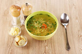 Tasty chicken stock with noodles on wooden background — Foto de Stock