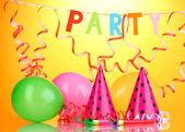 Party items on orange background — Stock Photo