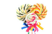 Colorful lollipops with ribbons isolated on white — Stock Photo
