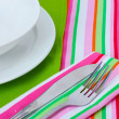 Table setting with fork, knife, plates, and napkin — Stock Photo #9940600