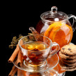 Glass teapot and cup with black fruit teand cookies isolated on white — Stock Photo #9949285