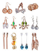 Beautiful gold earrings collection isolated on white — Stock Photo