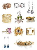 Beautiful gold jewellery collection isolated on white — Stock Photo