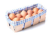Brown eggs in box isolated on white — Stock Photo