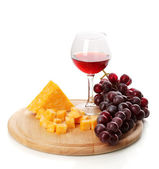 Wine in wineglass and cheese isolated on white — Stock Photo