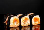 Delicious sushi on black background — Stock Photo