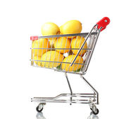 Ripe lemons in shopping cart isolated on white — Stock Photo