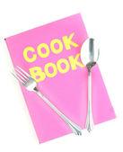 Na białym tle naczynia kuchenne i różowy książka kucharska — Zdjęcie stockowe