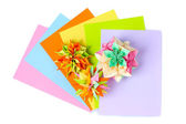 Colorfull origami kusudamas and bright paper isolated on white — Stock Photo