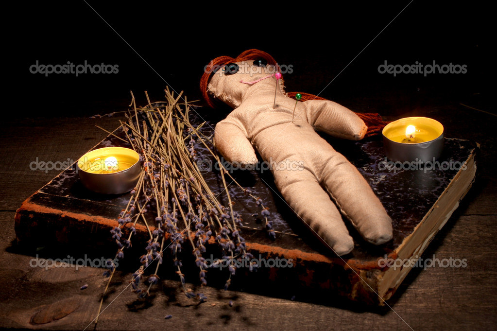 Voodoo doll girl on a wooden table in the candlelight — Foto Stock #9940388