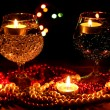 Amazing composition of candles and glasses on wooden table on bright background — Stock Photo #9965851