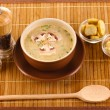 Tasty soup on wooden mat - Stock Photo