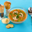 Tasty soup on blue tablecloth - Stock Photo