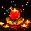 Wonderful composition with candle in glass on wooden table on bright background - Stock Photo