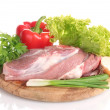 Raw meat and vegetables on a wooden board isolated on whit - Stock Photo