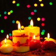 Beautiful candles on wooden table on bright background — Stockfoto