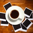 Photo papers with coffee on wooden background — Stock Photo #9991082