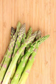 Delicious asparagus on wooden background — Stockfoto
