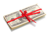 A lot of one hundred dollar bills tied red ribbon isolated on white — Stock Photo