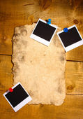 Photo papers with old paper on wooden background — Stock Photo