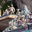 Statues on hindu temples at Batu caves - Stock Photo