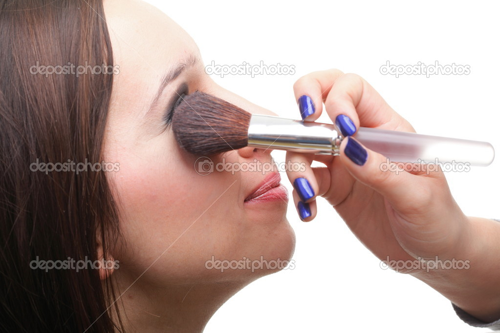 Beautiful young brunette woman applying powder with a brush isolated on white — Stock Photo #10005515