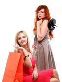 Lovely woman ginger and blonde with shopping bags — Stock Photo
