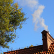 图库照片: Smoke from chimney sky blue