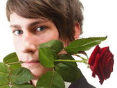 Young man, flower, red rose isolated — Stock Photo