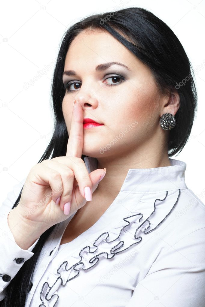 Young woman brunette girl asking for silence white isolated — Stock Photo #8410352